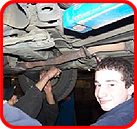 Working on underside of car