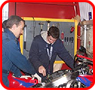 2 students working on motor bikes